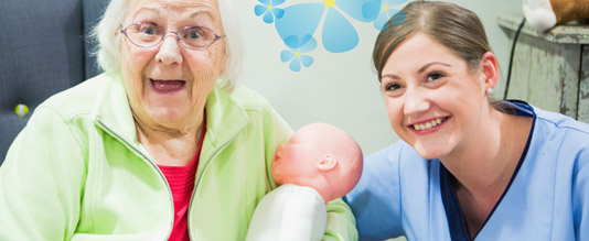 LM-Healthcare carer with resident and doll