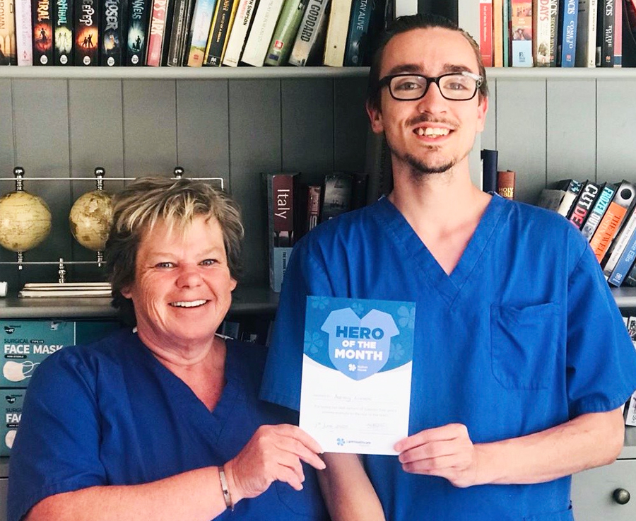 Ashley Lines receiving his Hero of the Month award from Hulton House Home manager, Sharon Haydock Myers